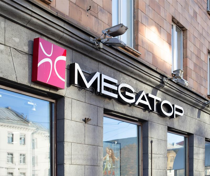 MINSK, BELARUS 17.10.2019: A sign of a store MEGATOP selling children`s and adult shoes for all seasons stock photos