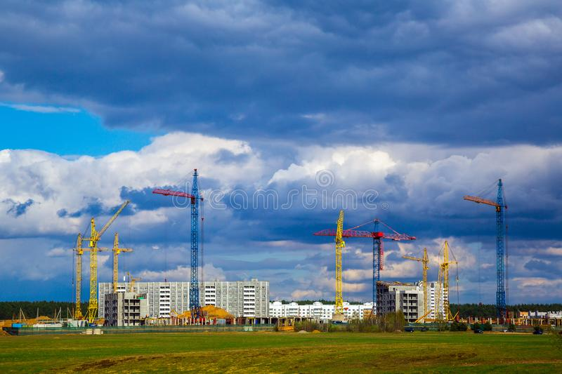 Minsk, civil engineering. Belarus, Minsk, 04-26- 2018; Modern civil engineering, industrial tower cranes against the blue sky; The modern urban landscape royalty free stock images