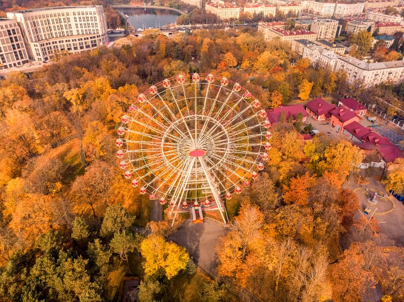Minsk ferris wheel autumn. Shot from high point at Minsk, Belarus royalty free stock photo