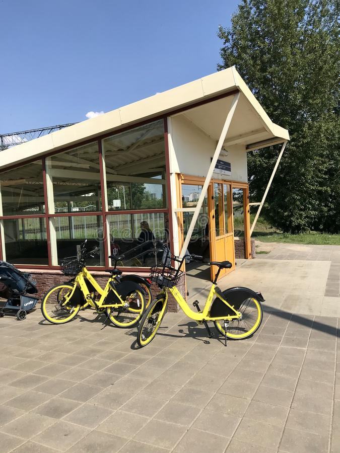MINSK, MINSK, BELARUS JULY 21, 2019, Stationary Bike Sharing. Bicycles for rental are located near the underpass of the railway stock photo