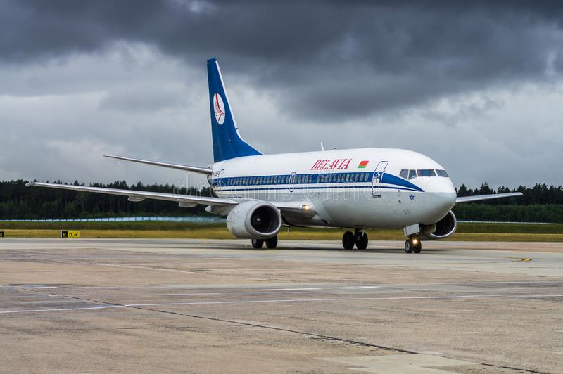 Minsk, Minsk National Airport, Belarus - July 16, 2015: Boeing 737-300  EW-282PA Belavia Airways.  royalty free stock photos