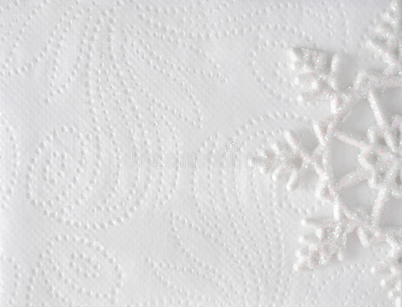 Minsta elegant bakgrund för jul Snöflinga på vitboktextur arkivfoto