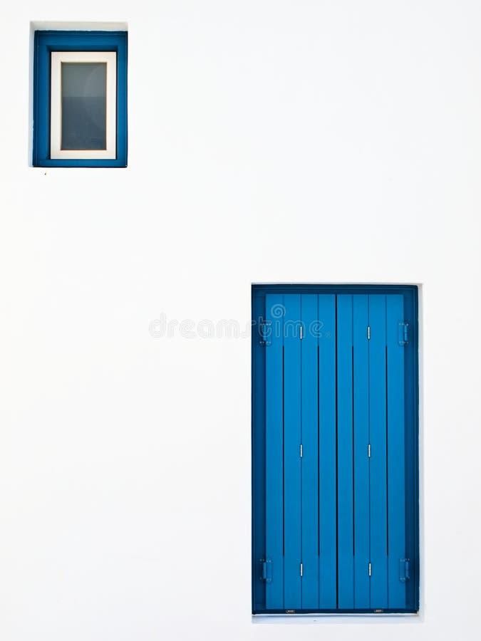 Minsta hus för blått för arkitektur vit och arkivbild
