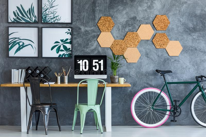 Mint chair in designer workspace stock photography