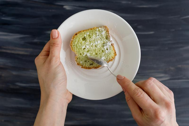 Mint cake on plate in hands, background dark surface stock photos