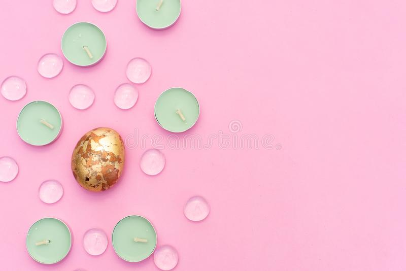 Aroma lamp, mint candles on pink background, dry flowers and gold leaf stock photos