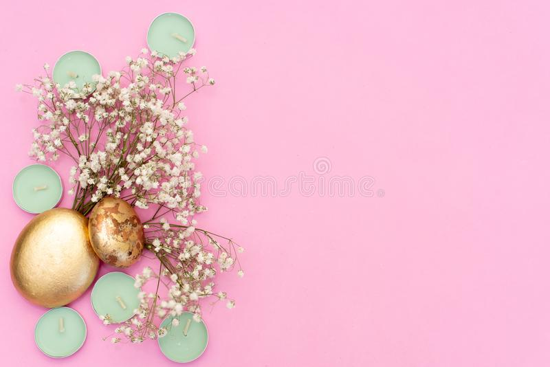 Mint candles on pink background, dry flowers and gold leaf stock images