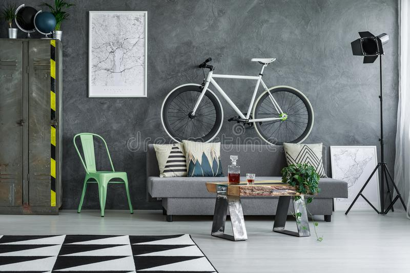 Guy living room with bicycle stock photos