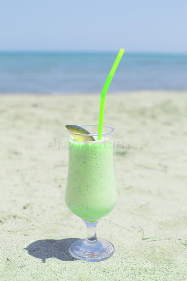 Mint Milkshake on the Beach decorated with lime stock images