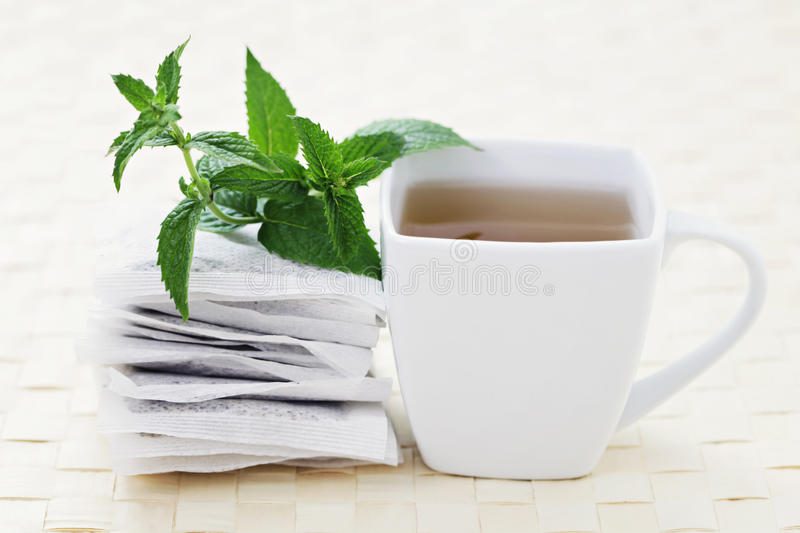 Mint tea. Cup of mint tea with fresh leaves - tea time /shallow DOF on mint royalty free stock photo