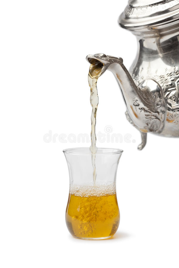 Mint tea poured in a glass royalty free stock photo