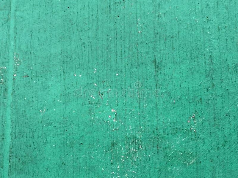 Mintkaramellgräsplanbakgrund på den gamla bakgrunden för cementgolvtappning Pastellfärgad färg arkivbild