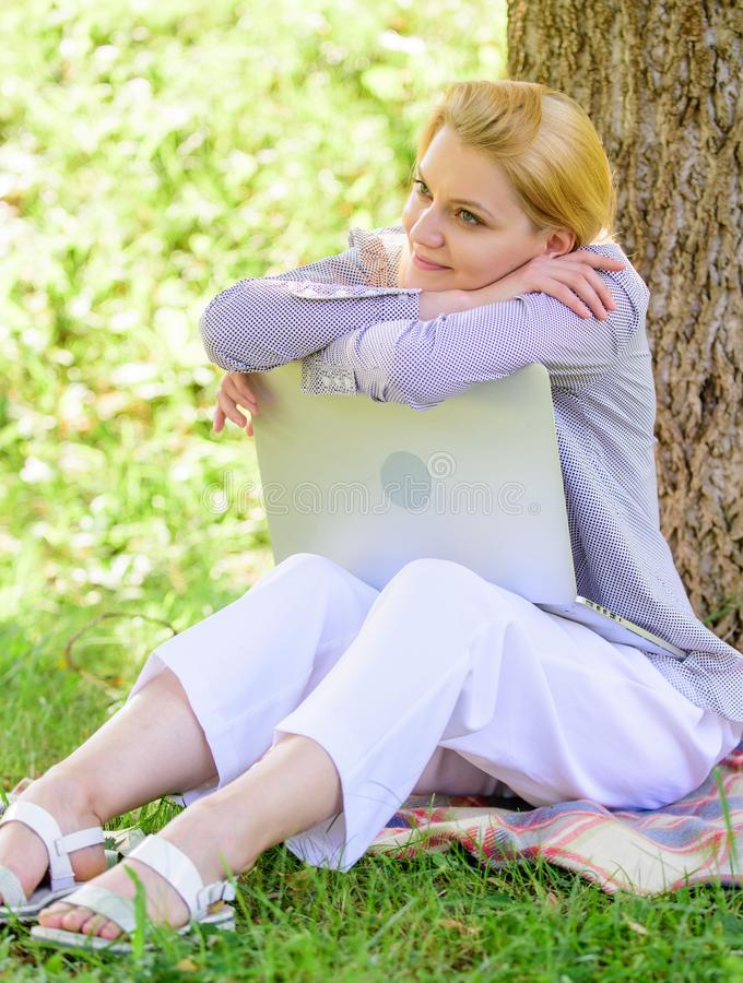 Minute for dream. Technology and internet concept. Dream about new job or relocation. Girl laptop dreaming in park sit stock images