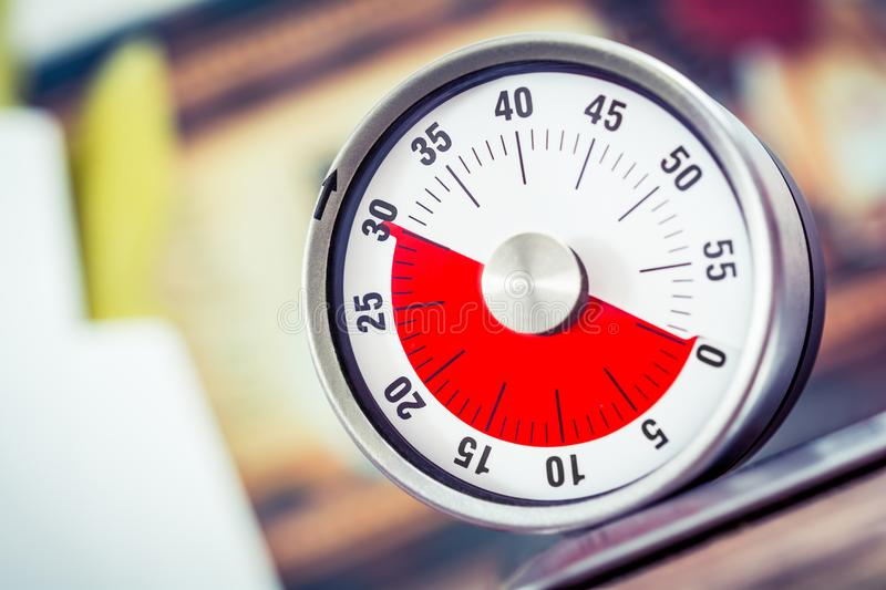 30 Minutes - Analog Kitchen Timer On Cooktop. A 30 Minutes - Analog Kitchen Timer On Cooktop royalty free stock image