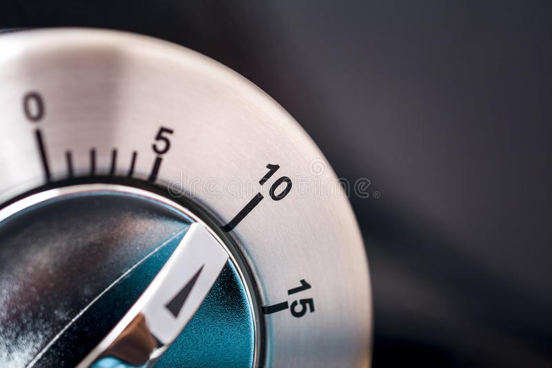 10 Minutes - Macro Of An Analog Chrome Kitchen Timer With Dark Background stock images
