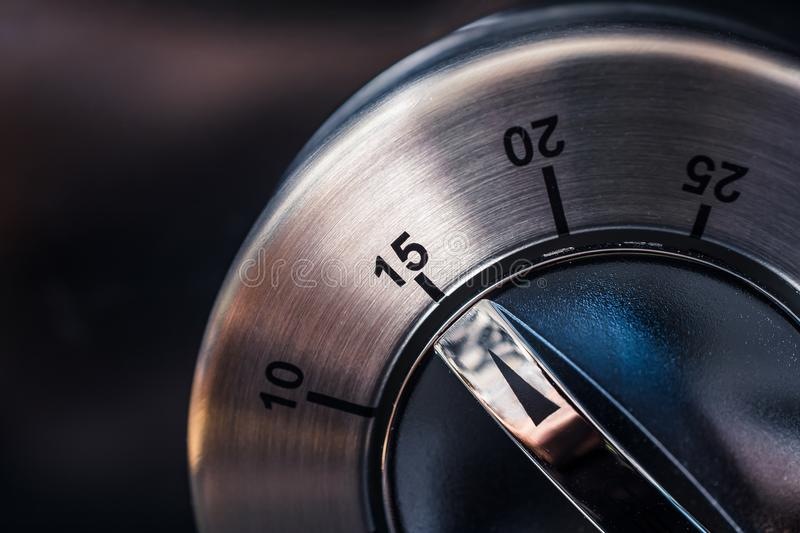 15 Minutes - Macro Of An Analog Chrome Kitchen Timer With Dark Background stock images