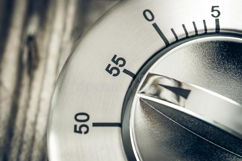 55 Minutes - Macro Of An Analog Chrome Kitchen Timer On Wooden T. Able royalty free stock photo