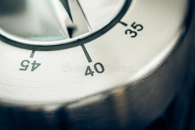 40 Minutes - Macro Of An Analog Chrome Kitchen Timer On Wooden T. Able stock photos