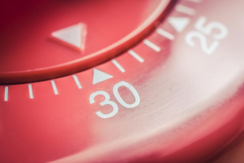 30 Minutes - Macro Of A Flat Red Kitchen Egg Timer royalty free stock images