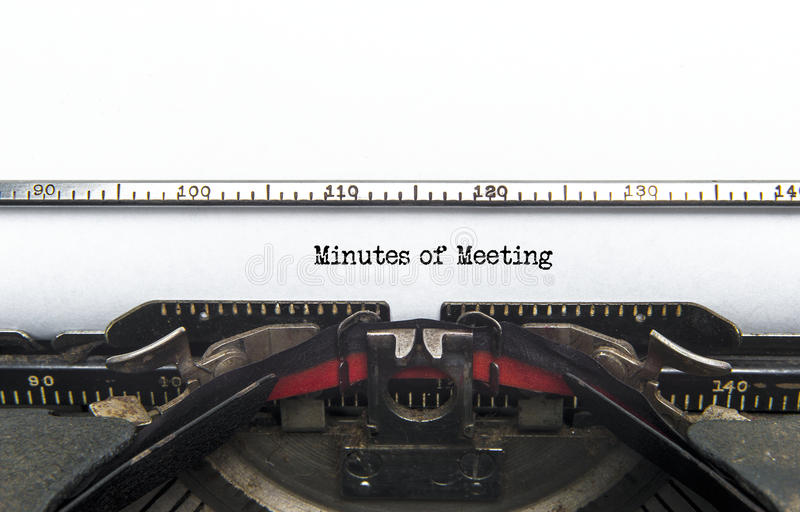 Minutes of Meeting. An old typewriter still going with the words Minutes of Meeting just been typed. Copyspace stock photography