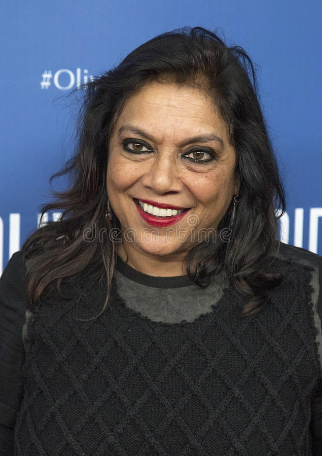 "Mira Nair. Director/filmmaker Mira Nair arrives on the red carpet for the New York premiere of ""Olive Kitteridge."" This is a 4-part drama series on royalty free stock photo"