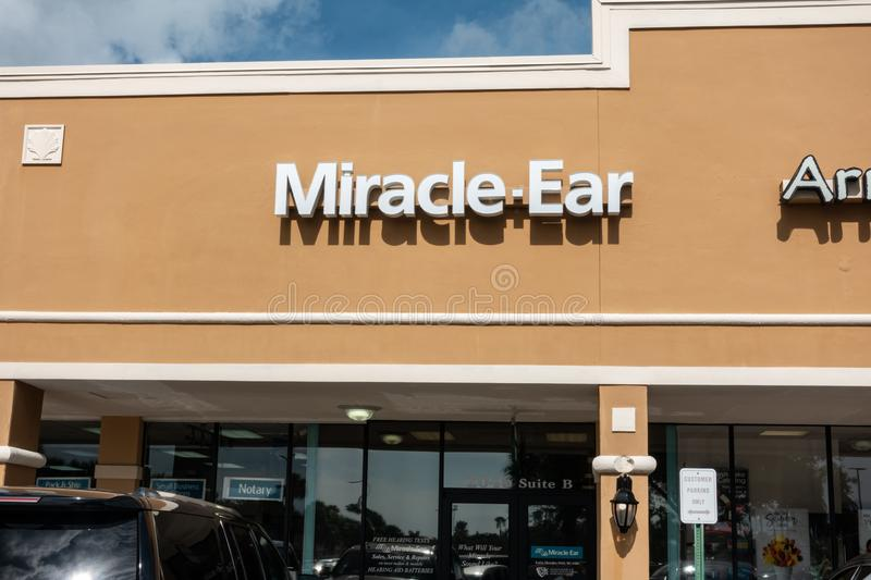 Miracle Ear storefront in a shopping center. Vero Beach, FL/USA - 8/2/19 - A Miracle Ear storefront which performs hearing tests, consultations, and sells stock photo