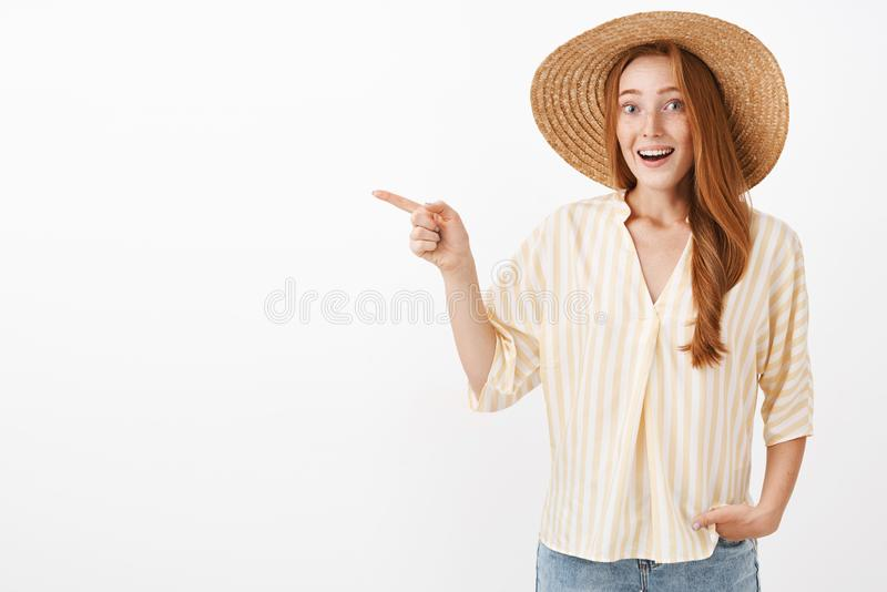 It is miracle look. Portrait of impressed and excited feminine timid redhead woman with freckles in straw hat and royalty free stock image