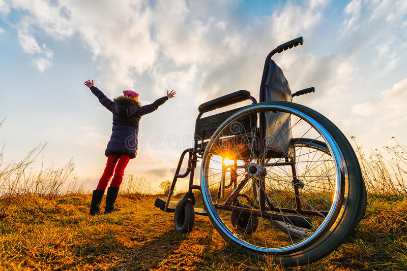 Download Miracle Recovery II: Young Girl Gets Up From Wheelchair And Raises Hands Up Stock Image - Image of lights, beautiful: 52521929