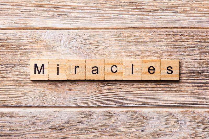 Miracles word written on wood block. miracles text on wooden table for your desing, concept royalty free stock photo