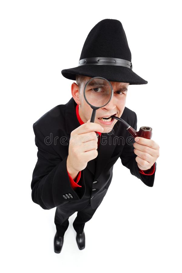 Mirada detective curiosa a través de la lupa imagenes de archivo