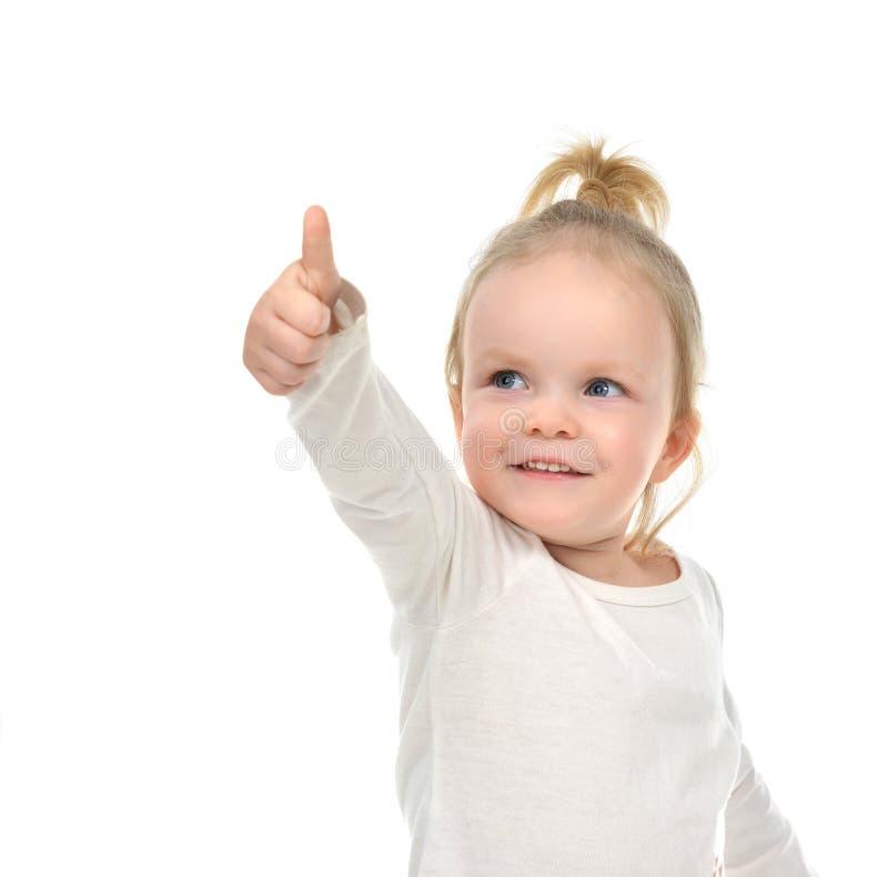 Mirada feliz del bebé del niño para arriba sonriente con el pulgar de la mano encima de la muestra fotos de archivo