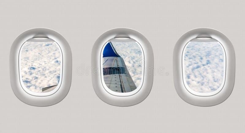 Mirada hacia fuera de las ventanas de un avión al ala de aviones y al clou stock de ilustración