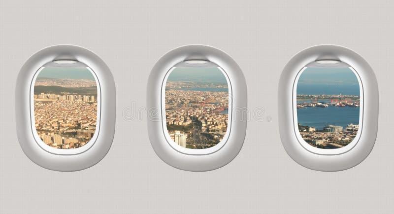 Mirada hacia fuera de las ventanas de un avión a la ciudad de Estambul libre illustration