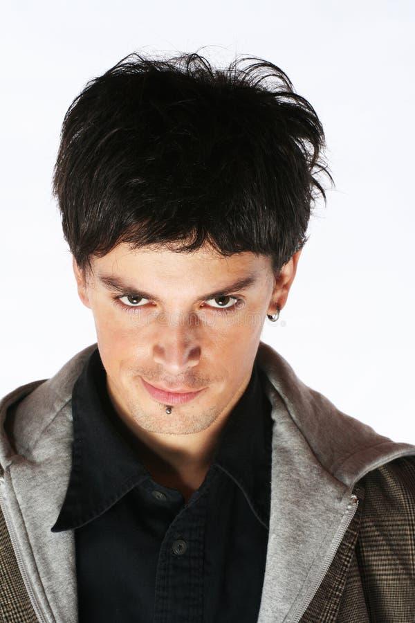 Mirada malvada - ojos del hombre del demonio imagenes de archivo
