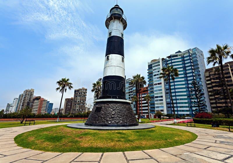 Miraflores Lighthouse. With palm tree - Miraflores, Lima, Peru royalty free stock photo