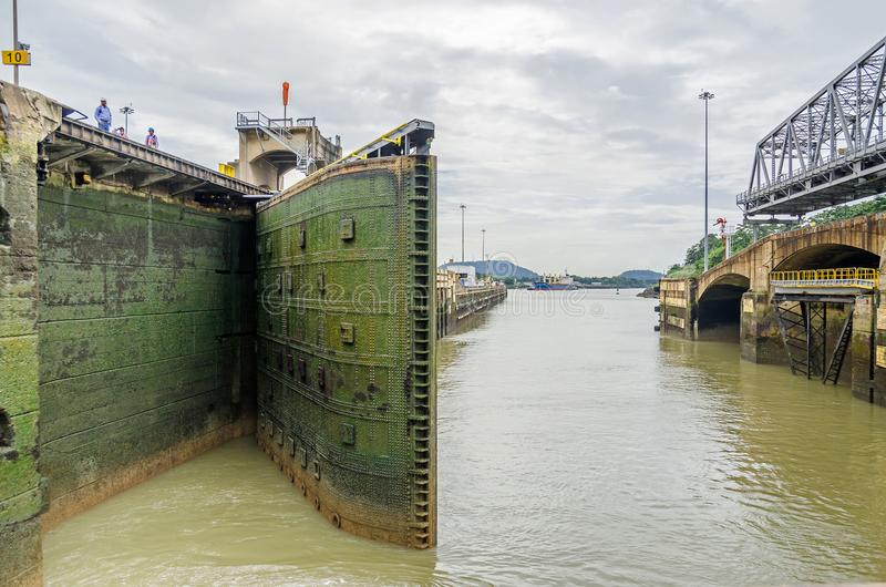 Miraflores Locks of the Panama Canal with lock gates closing. To fill the chamber with water and to lift ships royalty free stock image
