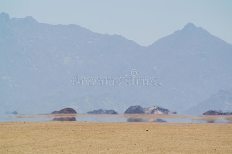 Mirage in desert royalty free stock photo