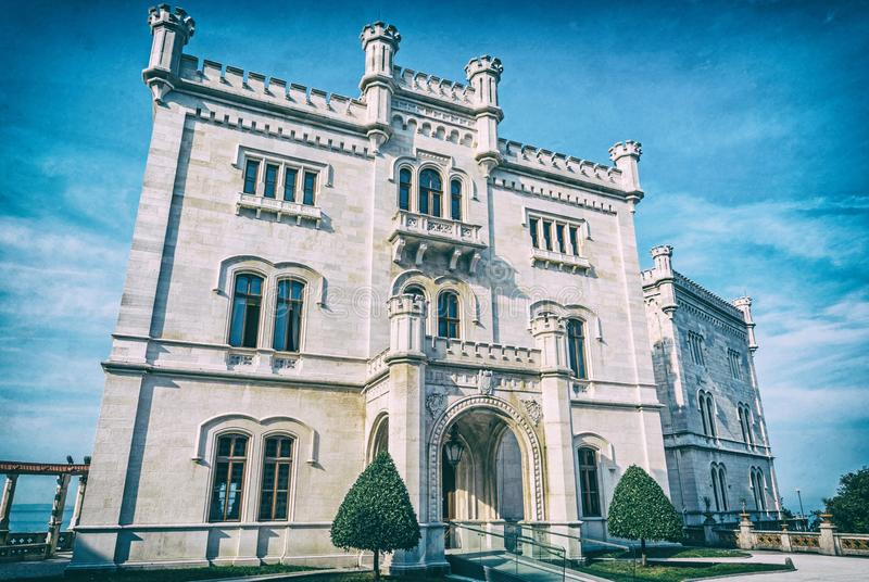 Miramare castle near Trieste, analog filter. Miramare castle near Trieste, northeastern Italy. Travel destination. Beautiful architecture. Analog photo filter stock images