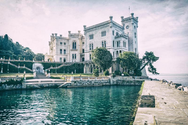 Miramare castle near Trieste, analog filter. Miramare castle near Trieste, northeastern Italy. Travel destination. Beautiful architecture. Analog photo filter stock photo