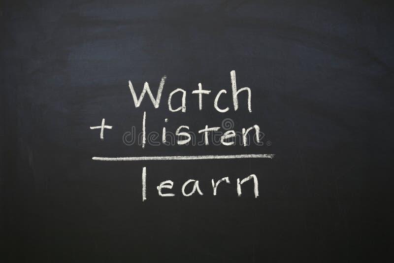 Mire para escuchar y para aprender foto de archivo