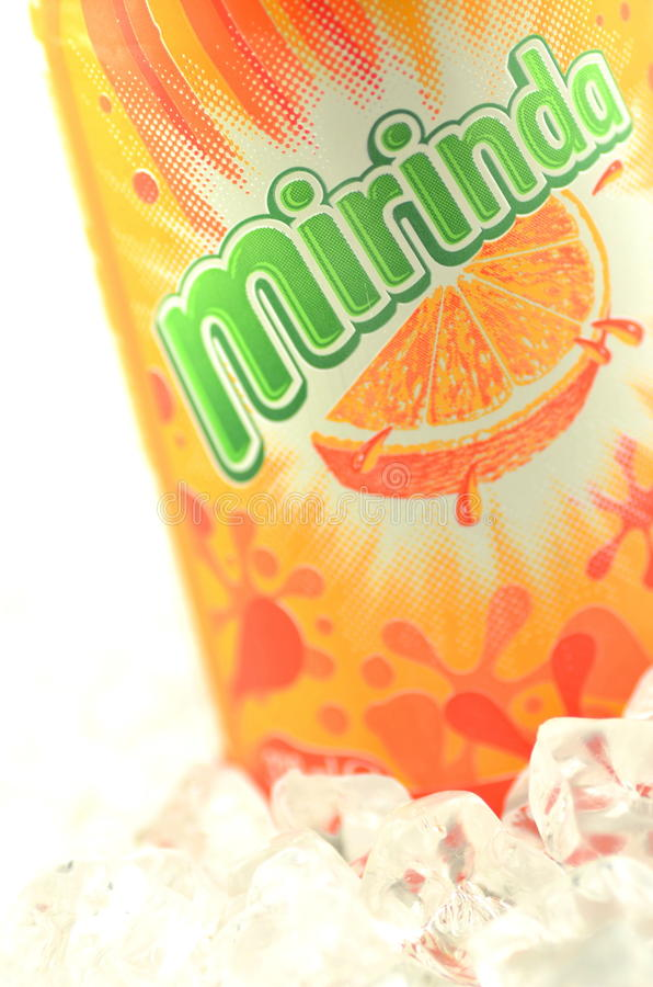 Mirinda drink in a can on ice isolated on white background. Mirinda is a soft drink created in Spain. Mirinda is owned by PepsiCo since 1970 royalty free stock image