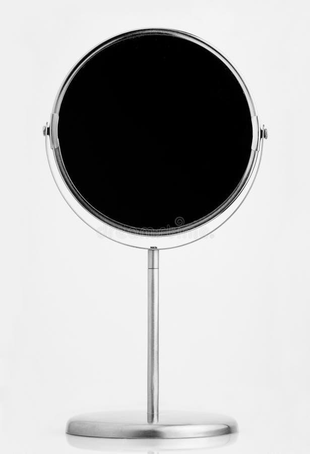 Miroir cosmétique sur le fond blanc image stock