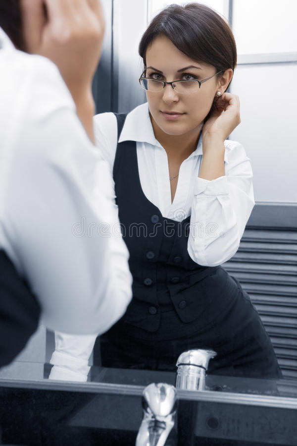 Download In mirror stock photo. Image of businesswoman, workplace - 12874938