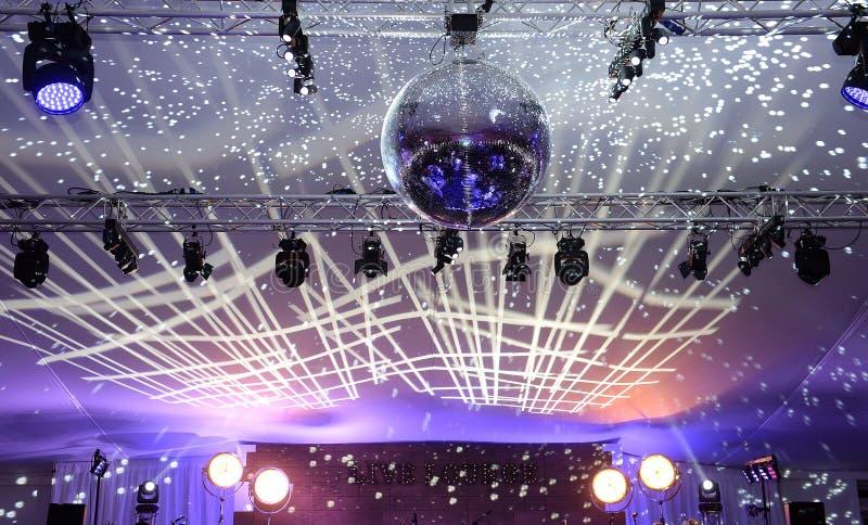 Mirror ball in ballroom. A ballroom or party space with a mirror ball and festive lighting stock photos