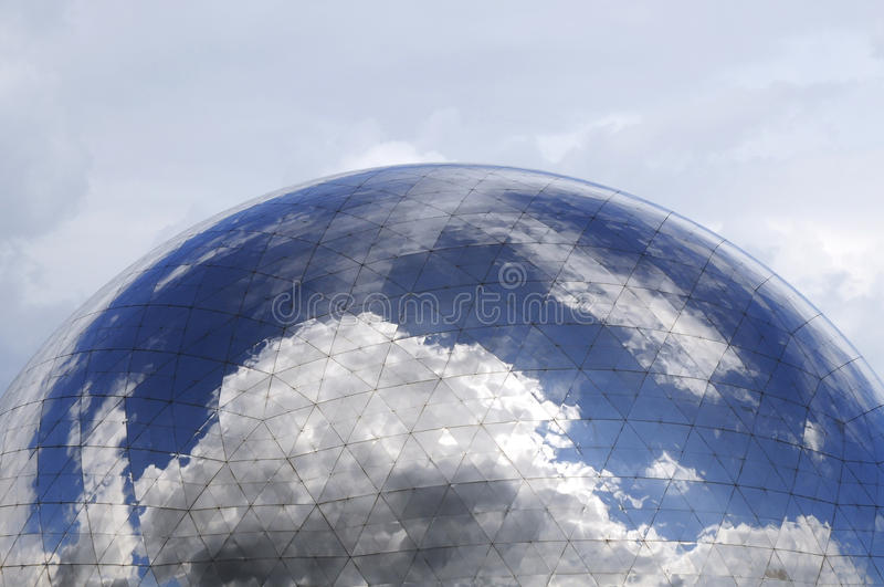 Mirror ball with magic. Cloudy sky reflect on the glass surface royalty free stock images