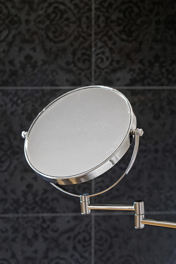 Mirror beauty. Double sided beauty makeup mirror at wall in bathroom royalty free stock images