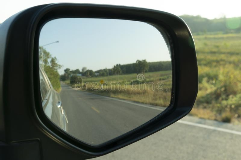 Mirror beside car with nature background at upcountry. stock image