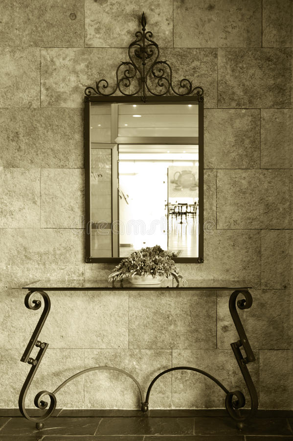 Mirror detail. Of a Luxury Hotel lobby with morning light bi tone vertical stock image