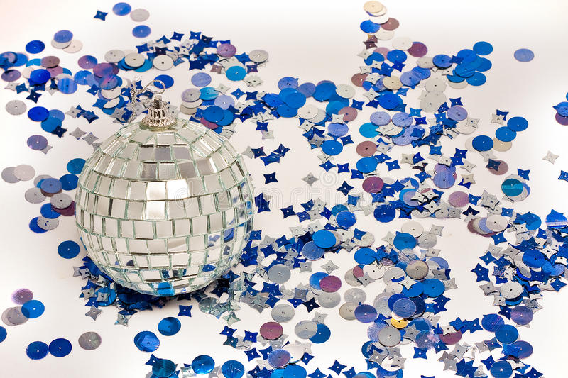 Mirror discoball with blue confetti royalty free stock photography