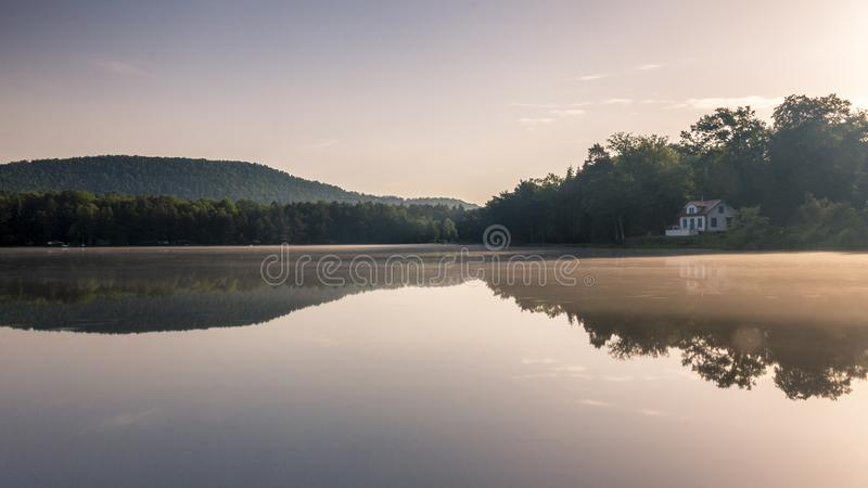 Mirror effect on a French lake royalty free stock photo